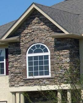 This is one of the kinds of stone exterior I like and paired with cedar shingles. and white trim.