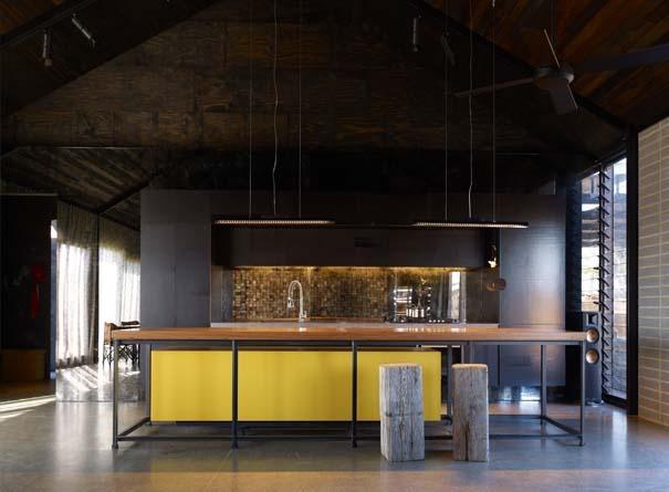 Black, yellow and timber kitchen. Wolveridge Architects