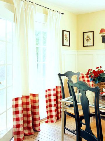 Repeat Color- Cheery checked window treatments in the breakfast nook echo the red tones of the kitchen. Keeping the top two-thirds of the linens neutral helps the space feel light and airy.