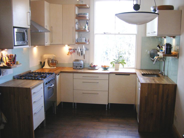 A customised free standing Ikea kitchen clad with birch ply panels and doors. Oak worktops wrapped over cabinet ends with glass splash backs above. Woodwork and design by Quality & Precision Ltd (Marc Ellis)