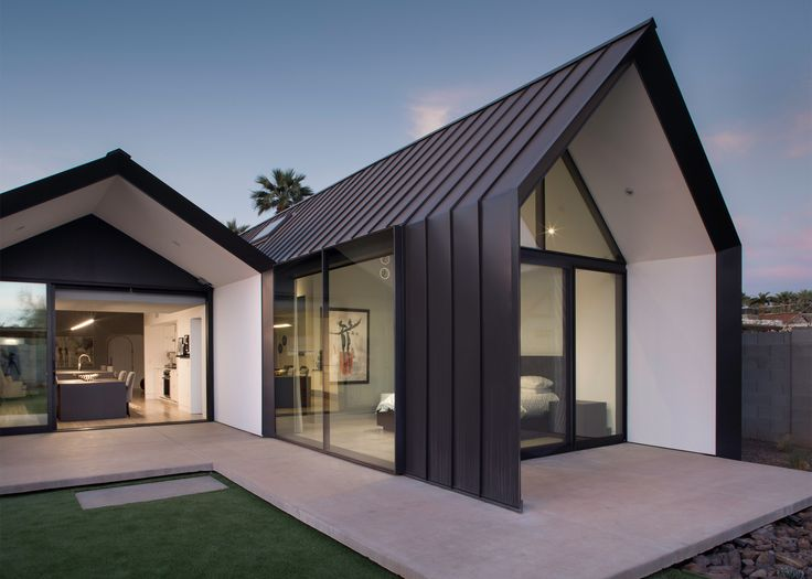 Chen + Suchart creates a gabled metal addition clad to an Arizona home