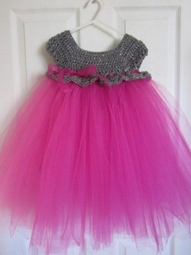 A lovely handmade crochet dress with tulle skirt.%0ASparkly grey and hot pink for your little princess.%0A%0AI LOVE custom orders if you prefer a different color or size, let me know!%0A%0AAvailable in sizes ne