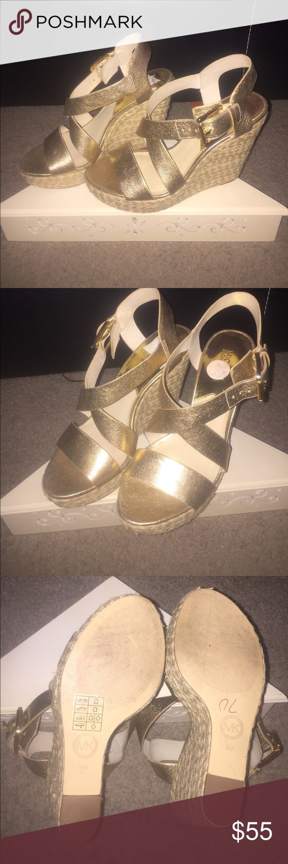 Gold Michael Kors wedge sandals Gold strappy sandals with woven straw heel. Only wore once to a wedding. Sandals are like new. Inside of the sandals have some sticker residue from price tag and can be removed. I removed as much as I could but it is not noticeable when wearing. MICHAEL Michael Kors Shoes Sandals