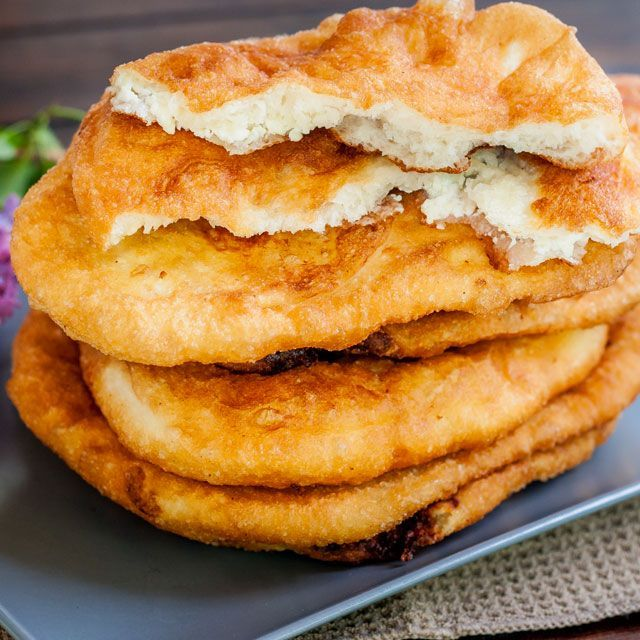 """Fried Dough Filled with Feta Cheese a.k.a. """"Langosi cu Branza"""" - a traditional Romanian popular street food. Delicious fried dough filled…"""