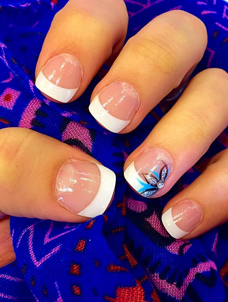 Acrylic nails design spring flower with rhinestone and a little blue simple but elegant love it ! French tips!