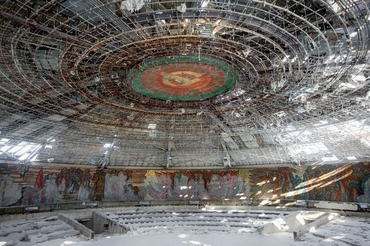 Abandoned Soviet monument in BulgariaNo, this isn't the remains of Darth Vader's spaceship after a rebel attack. It's Buzludzha, an abandoned Soviet monument in Bulgaria, opened in 1981 that's fallen into ruin.  Murals of Soviet and Bulgarian history adorn the walls, but the roof, which was made of valuable copper, has been stripped off, leaving the inside exposed to the harsh winters. The picture above is of the massive central auditorium.