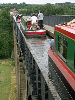Narrowboats on Llangollen Canal crossing the Pontcysyllte Aqueduct, Wales, UK