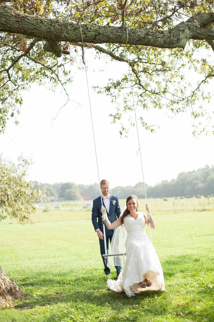 Fun, summer wedding with bride on a swing @Farrar Hill Farms. Wedding photography by Krista Lee Photography. From Alexis & Jagger's wedding. #brideandgroom      Wedding ceremony and reception venue: @Farrar Hill Farms, Manchester Tennessee     Coordinator: @Michelle Farless    Hair and Makeup: @Beauty by K2- @Katie Kendall      Wedding dress: @White Room  Groom and Groomsmen Tuxes:   @JOS A Banks #weddingmakeup