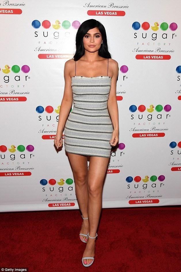 Kylie Jenner wearing Bec & Bridge Icebergs Stripe Mini Dress and Stuart Weitzman Nudist Sandals