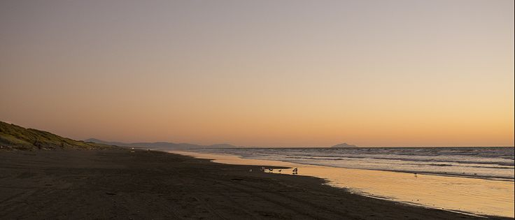 Kapiti Island and South Island in the background. Foxton Beach NZ