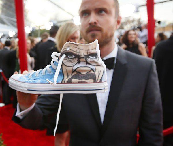 """""""Breaking Bad"""" actor Aaron Paul signs a shoe."""
