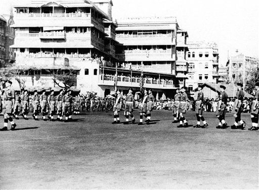 Troops of the Somerset light infantry, last British troops to leave India, parade in Bombay, on Feb. 28, 1948, prior to their departure for the United Kingdom aboard the empress of Australia. In center are the regimental color bearers. In left center background is part of the guard of honor provided by units of the Indian Army. (AP Photo)
