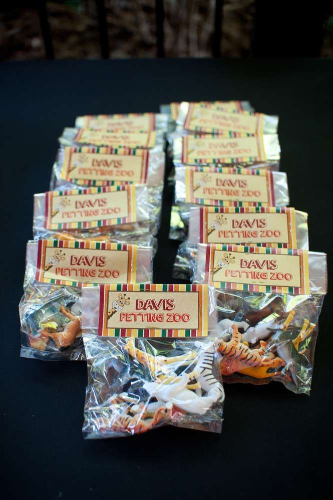 These would be cute favors for a Noah's Ark party! Animal figurines available at Party City.