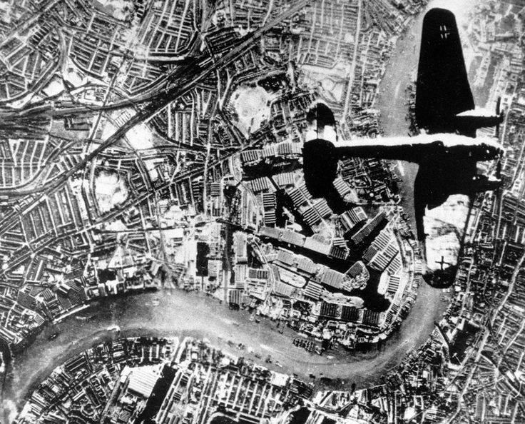 A Nazi Heinkel He 111 bomber flies over London in the autumn of 1940. The Thames River runs through the image. (AP Photo/British Official Photo)