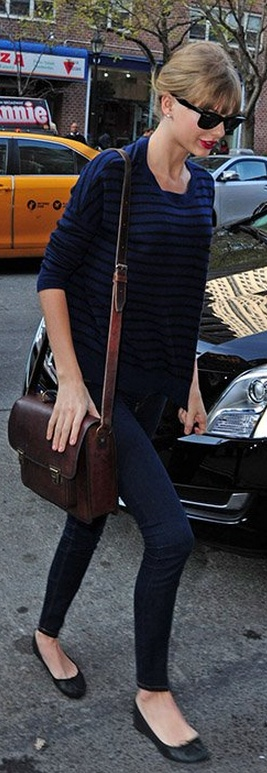 Who made  Taylor Swift's blue stripe sweater, brown leather handbag, black sunglasses, and black ballet flat shoes that she wore in New York on December 3, 2012?