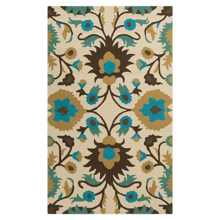 Anchor your dining set or patio seating group in chic style with this handcrafted rug, showcasing an oversized botanical-inspired motif.
