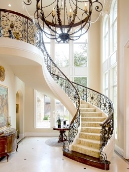 Elegant Winding Staircase With Wrought Iron Details. At 9996 Hollow Way,  Preston Hollow