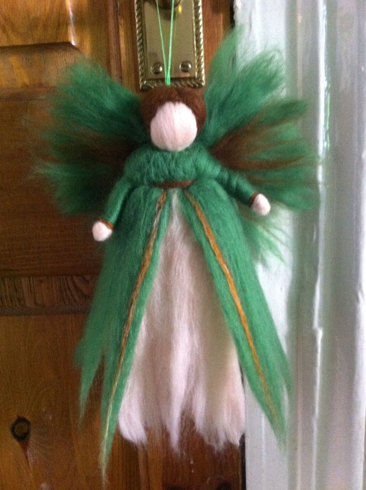 Hand needle felted fairy.  Www.facebook.com/brownharedesign