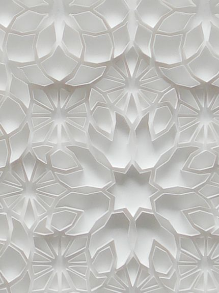 what a beautiful pattern in shades of white and light gray!  Pretty impressive paper cutting/folding!    http://www.mattshlian.com/