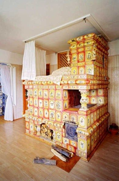A tile-covered Russian stove with a place for sleeping on its top.