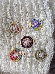 These look like Dorset Buttons although they are sold as Ring Work Shawl Pins.