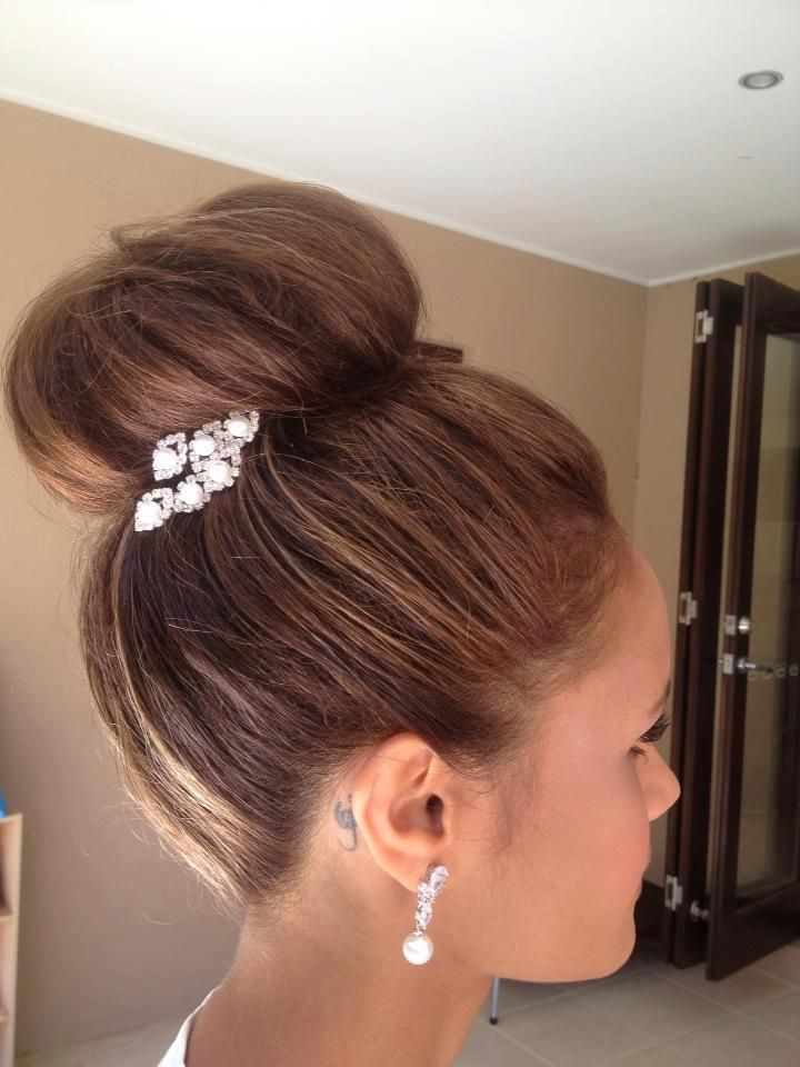 Beautiful high bun... wonder if I could pull this off, with some extensions? wedding hair