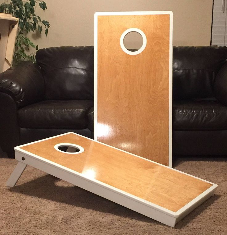 Each and every cornhole board is made with pride and built to last.  The top of the board is cherry stained. The trim can be painted to color of your choice. The bottom of board will be painted to match the frame and trim and clear coated for added protection. Each board is clear coated with water based polyurethane. Each cornhole boards starts as a 5 x 5 sheet of 3/4 (18mm) Baltic Birch and handmade into a cornhole board. The tops are cut to regulation 48 x 24 and the hole cut at 9 done...