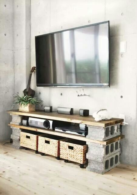 Here is the solution to the kids storage area beneath the TV. Problem solved.