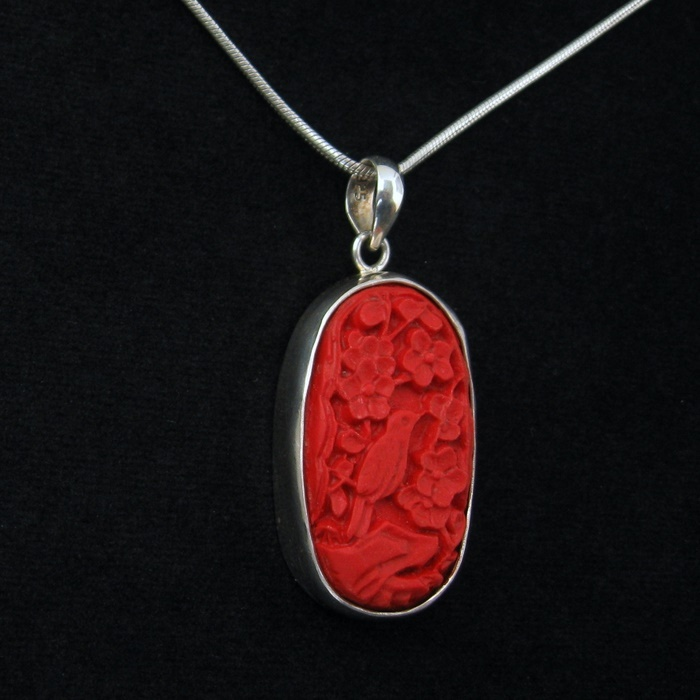 A LotusMoon handmade red cinnabar pendant. $89