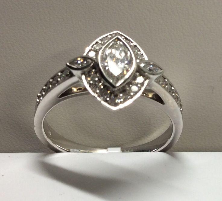 White gold & diamond reflecting Art Deco glamour.