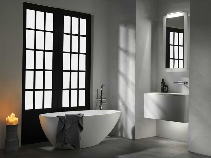 Photographic Gallery A sleek standing tub from Abbrio looks beautiful in this modern minimalist bathroom http