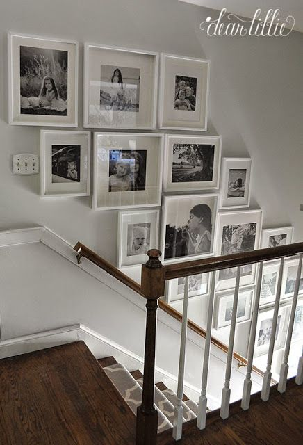 b&w gallery wall. I like the chair rail they added...this could work for our rear stairway.