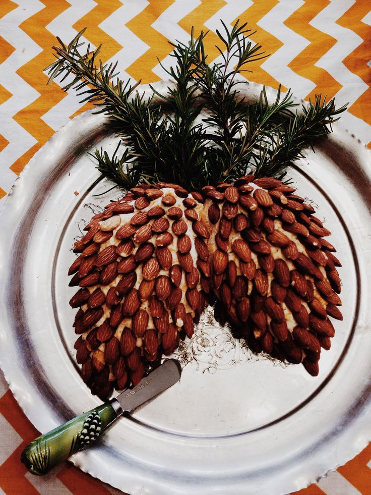 Cheeseball with almonds & rosemary sprigs to look like pine comes! Genius!!