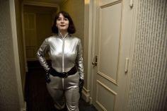 Zoe Heriot photoshoot.  Silver PVC catsuit.
