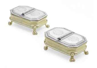 A PAIR OF GEORGE II SILVER-GILT DOUBLE SPICE BOXES MARK OF BENJAMIN GODFREY, LONDON, 1734 Each rectangular with canted corners, on four scroll feet, the hinged cover with gadrooned border, each cover engraved with a coat-of-arms within a garter motto, with later ruby glass liners, marked under bases and on each cover A Brilliant Silversmith who died far too Young  his widow Eliza  carried on with their business 2 boxes sold for  $104,500