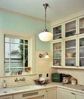 Kitchen With Penny Tile Countertop, Subway Tile, Cream And Seafoam Paint,  And Schoolhouse