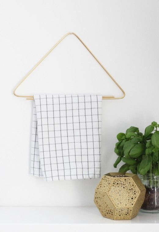 Brass rod turned kitchen towel hanger