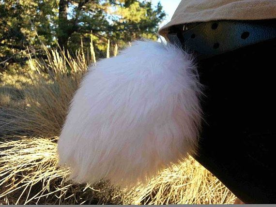Make a furry fashion statement with AnthroWear Feral Apparel!    Handmade Bunny Tails!  Every tail is made brand new by hand at the time of purchase.
