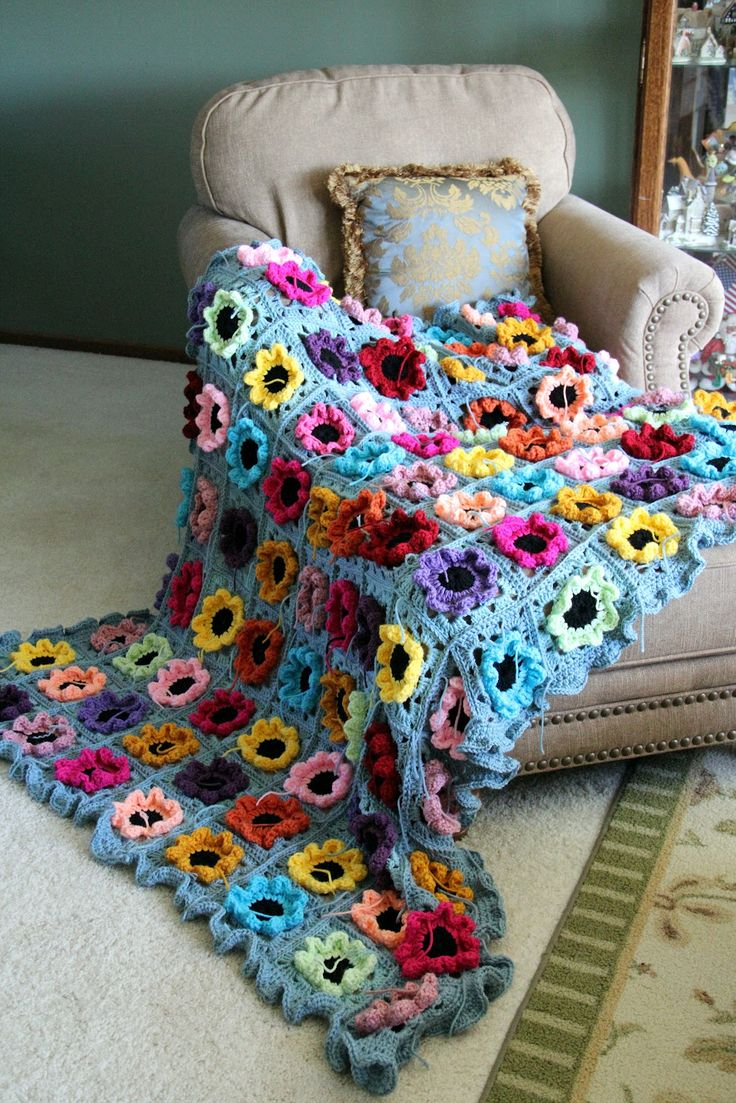 gorgeous afghan with flower granny squares    All these projects for the yarns from mom's stash