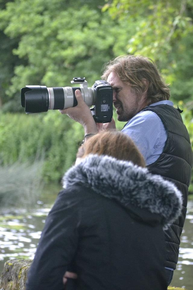 Photographer in action::