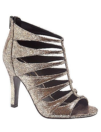Go for the bold in this daring gold metallic strappy heel. Designed for comfort in wide widths with a stable, tapered heel and non-slip sole to keep you on your toes and a zip-up back for easy entry. lanebryant.com