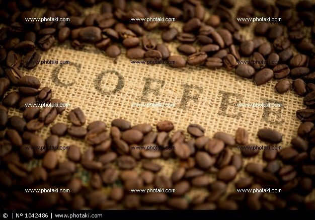 http://www.photaki.com/picture-coffee-beans-surrounding-coffee-stamped-on-sack_1042486.htm