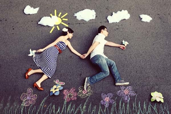 Creative Photo Shoot Themes   with chalk paintings and props as the photographer shoots from up high ...