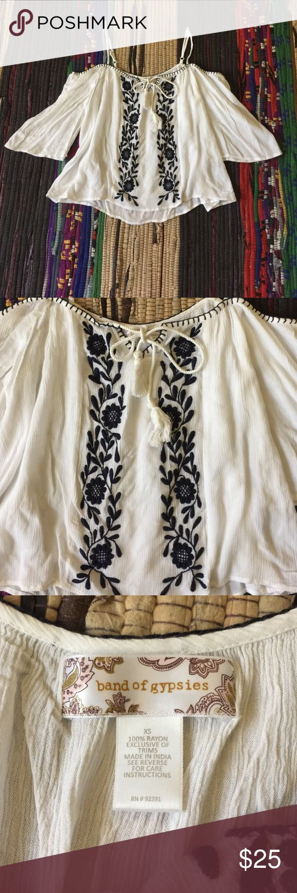 Band of Gypsies cold shoulder crop top Boho cold shoulder crop top by Band of Gypsies. This will be your new favorite shirt. The cutest top to pair with high waisted denim and booties to instantly look boho chic. Soft white gauzy material with navy embroidery down the front. Tie in front with tassels. Adjustable spaghetti straps. Size XS. Worn once. Urban Outfitters Tops Crop Tops