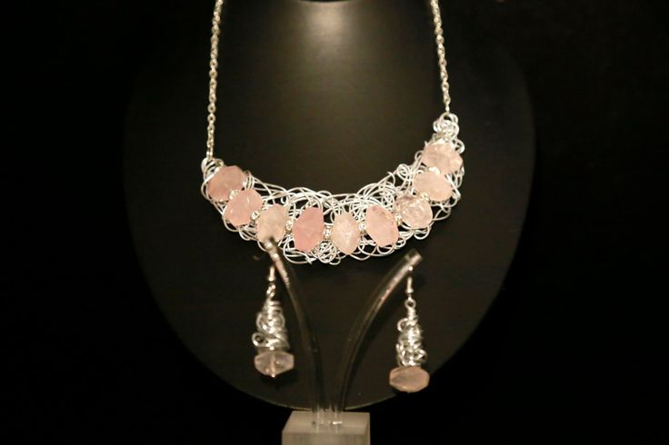 Entangled wire necklace embellished with rose quartz faceted nuggets with…