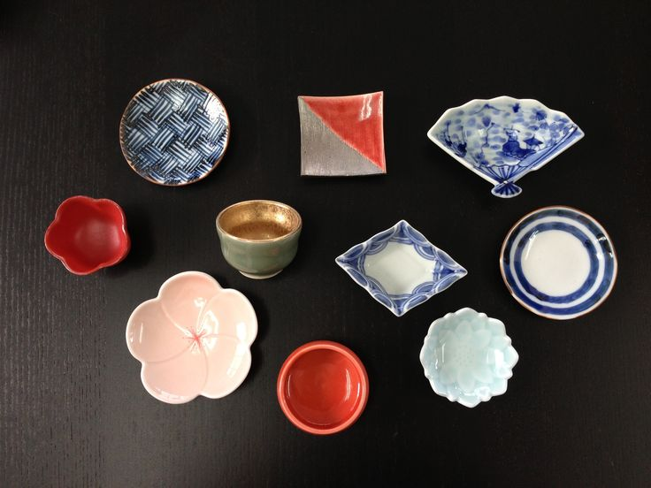 Small plates and cups for Japanese traditional multi-course dinner, Kaiseki. Japanese Arita ware.