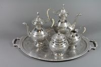 Lot 1069 - An Eastern engraved silver 5 piece tea/coffee set comprising oval tea tray, teapot, coffee pot, milk jug and sugar bowl, marked 84, 124 ozs £300-500