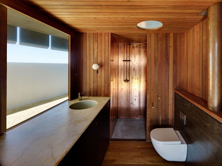 light house / peter stutchbury architecture / gold drop marble, copper, mixed red hardwood