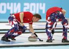 Image: Norway's Torger Nergaard (left) sweeps the ice during the men's curling tie-breaker match against Great Britain on Tuesday at the Soc...