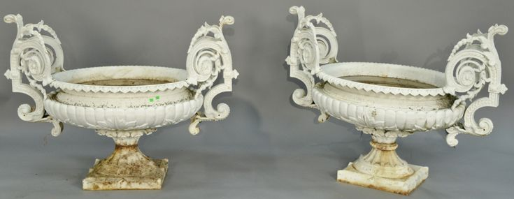 Pair of Victorian iron urns ~ Realized Price $7,800.00 #nadeausauction